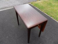 Stag dark wood side/games table. Excellent quality, small swivel top table, complete with a drawer.