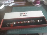 Amore & Back charm bracelet, sterling silver with crystals, 14 charms in red and silver