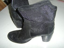 BOOTS IN SIZE 7 ,grey in color.
