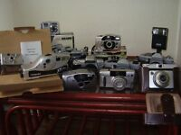 large collection of photographic /slide/ items/ cameras/ lenses/ editor/loads of stuff bargain