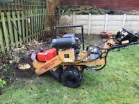 Stump grinding with operator
