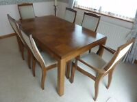 Well looked after oak dining table, 6 chairs, oak sideboard and glass display unit over