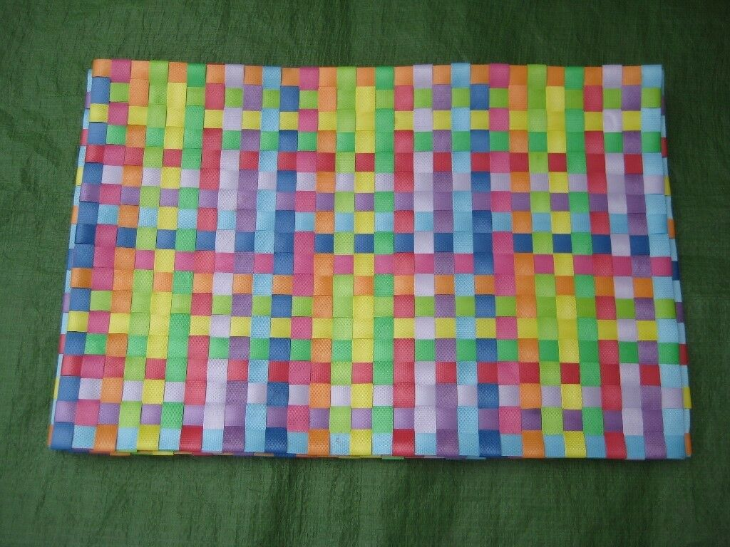 Four Multi-Coloured Plastic Table Mats for £2.00