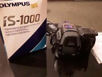 Olympus IS 100 SLR Camera 35-135mm good condition