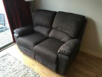 Black and Grey Reclining Sofa - in good condition.