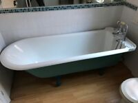 Large cast iron roll top bath