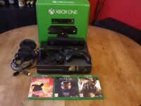 Xbox One console with Kinect and three games.