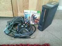 Xbox 360 console with wireless controller and games