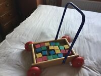 Wooden Baby Walker with coulered blocks.