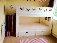 Beautiful handmade bunk beds. Including draws and stair gate. 1 year old. Selling due to house move