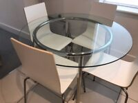 Glass dinning table WITH 4 Chairs from IKEA