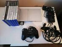 Playstation 2 silver slim console, 7 games, 16mb card and Technopro controller,