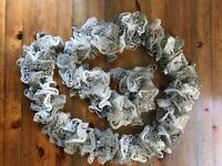 Homemade hand knitted ruffle scarf