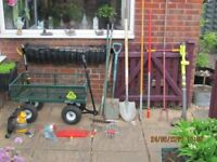 Selecton of garden hand and power tools.