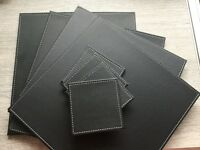 Set of brand new reversible table mats and coasters