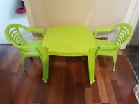 Green plastic table and chairs
