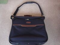 Dark blue suit bag with brown trim in excellent condition
