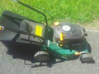 3 petrol lawnmowers.