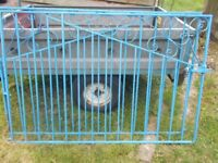 A PAIR OF PAINTED METAL GARDEN GATES