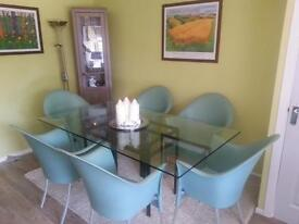 Stylish glass topped table - seats 6/8