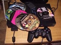 PLAYSTATION 2 WITH GAMES ,,