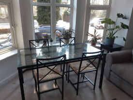 Stylish glass and metal table with 4 matching chairs