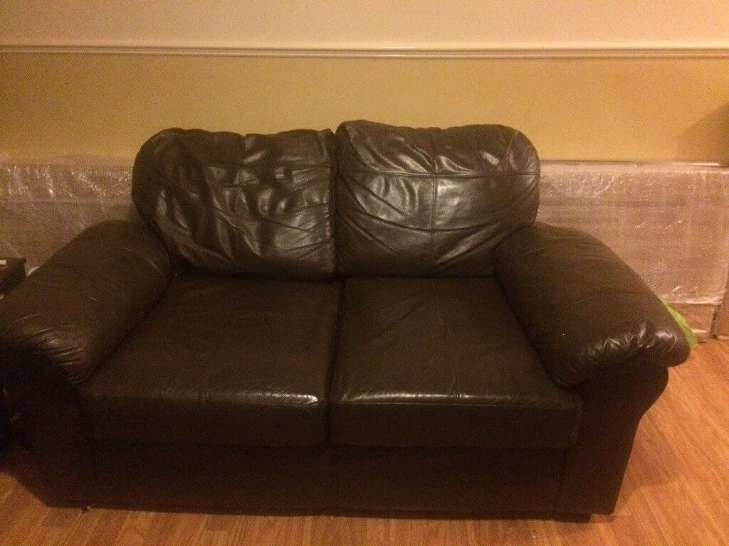 Two chocolate brown leather sofas