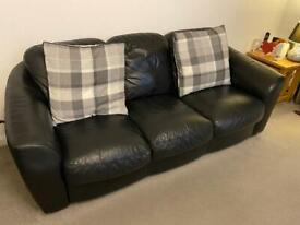 Genuine black leather Harvey's sofa, 3 seater, 2 seater and footstool with storage.