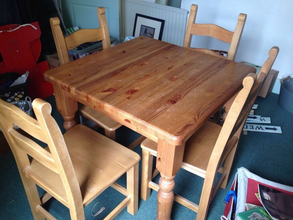 solid wood pine four piece dining room table and chairs in