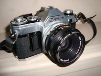 Canon AE1 Camera + canon Speedlight.