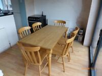 Mica Top Oak Farmhouse Style Table and six chairs. Excellent condition.