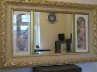 An unusual decorative bevelled wall mirror with floral inserts
