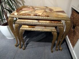 Onyx topped brass tables...set of three and heavy