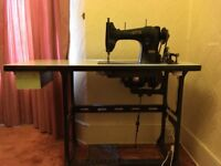 Vintage electric Singer Sewing machine. Complete with table and accessories.