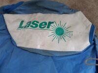 Laser dinghy trailing under cover