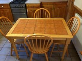 Solid table and four chairs.