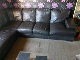 Large leather corner sofa with pouffe