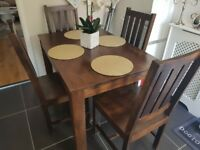 Dark wood dining table +4 chairs