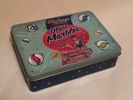 A RETRO STYLED TIN OF MARBLES