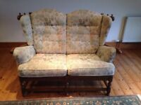 Ercol cloiser two seater settee. Traditional wood finish