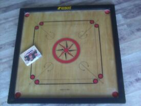 CARROM BOARD AND CARROMMEN. 32 INCHES X 32 INCHES.