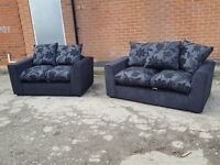 Very nice Brand New sofa suite.black with scattered cushions.3 and 2 seaters in the box. can deliver