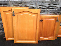 Solid wood quality kitchen doors with all hinges and brass handles. Good condition