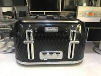 Black Breville toaster and kettle