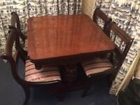 Dark wood table and 6 chairs