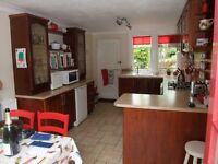 Complete kitchen. Mahogany units in good condition plus hob and oven.