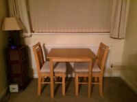 Two dining chairs and table solid pine