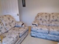 2 Two seater sofas, cream and brown subtle flower pattern.