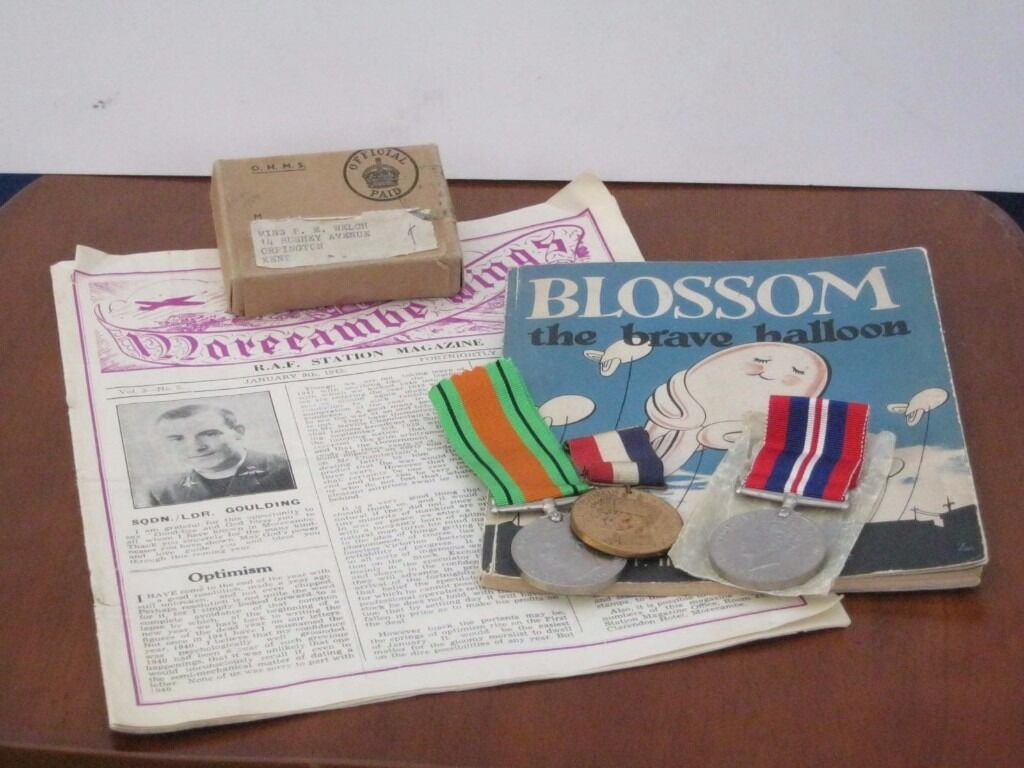 World War II medals with postal box, RAF magazine and book