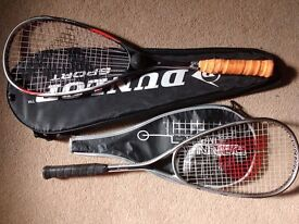 PAIR OF SQUASH RACKETS, DUNLOP AND DONNAY, BOTH WITH COVERS AND YELLOW DOT BALL.